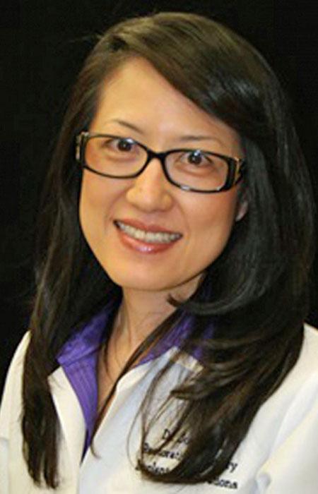 Judy Yuan smiling at camera