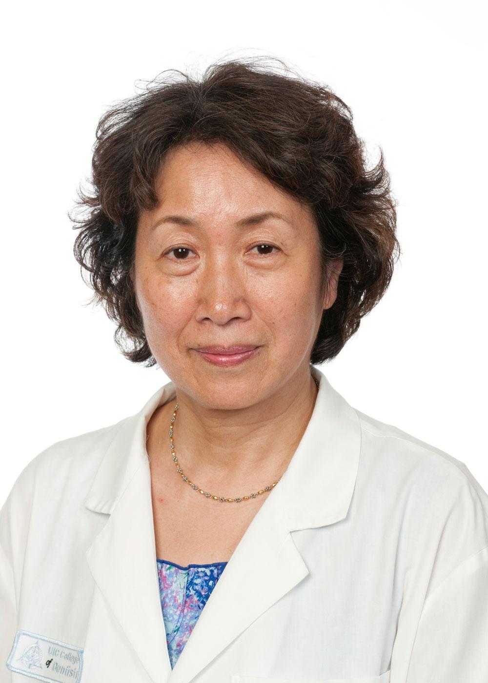 Keiko Watanabe smiling at camera