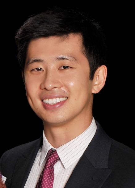 Kevin W. Luan smiling to camera