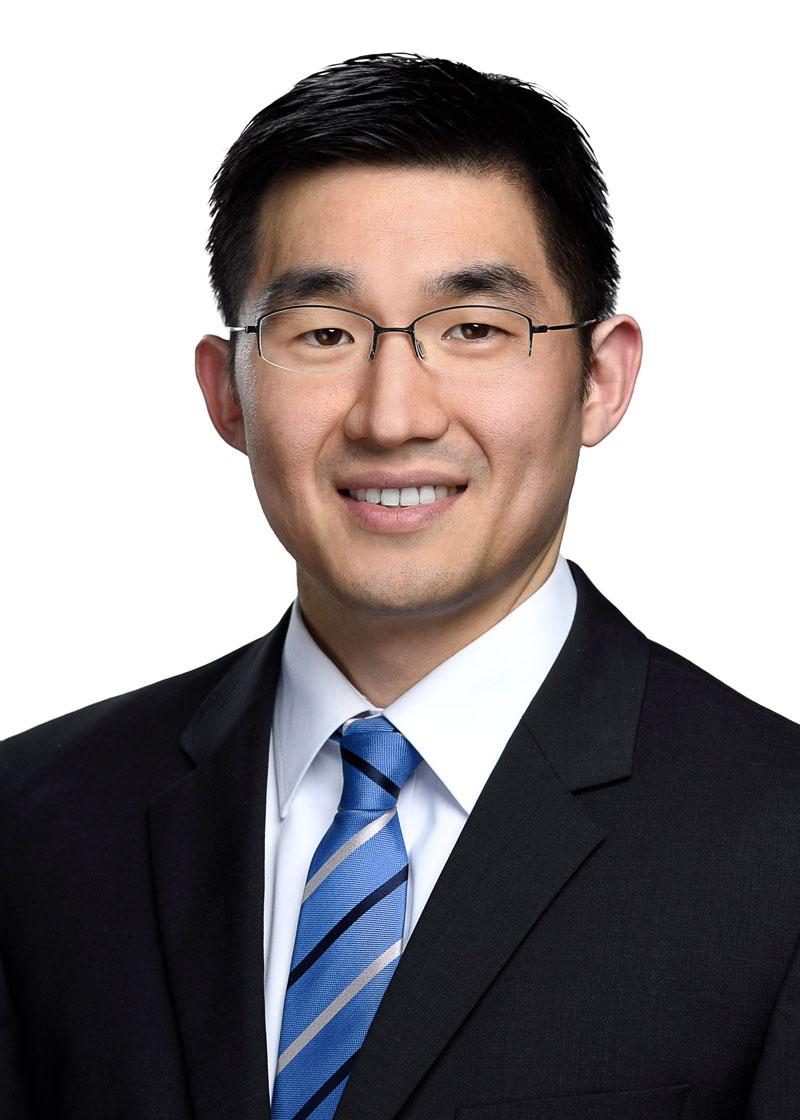Michael Han smiling to camera