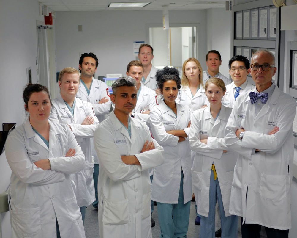group of dentist standing and looking at the camera