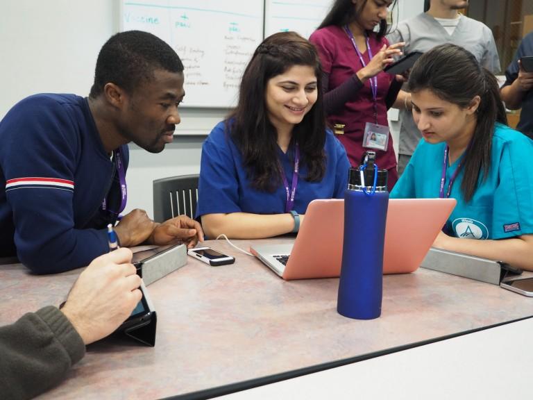 students staring at laptop