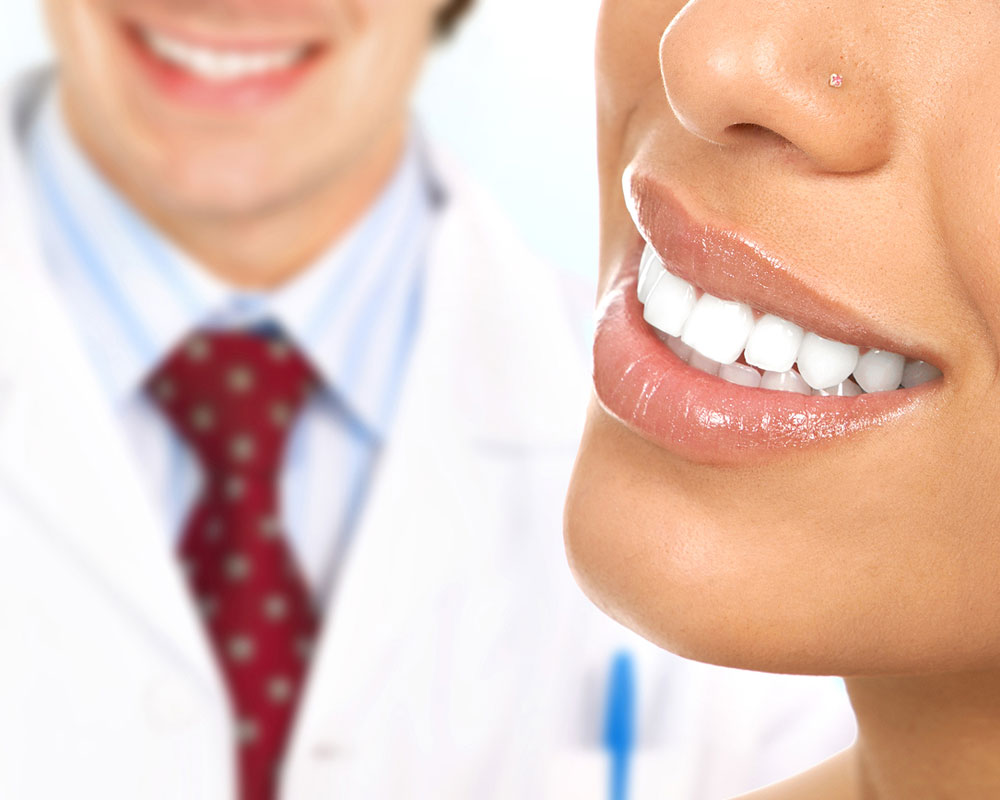 patient and doctor smiling