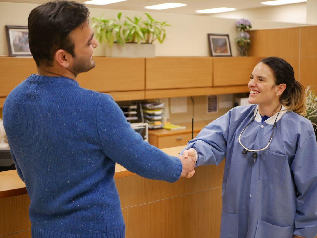 man shaking dentist hands