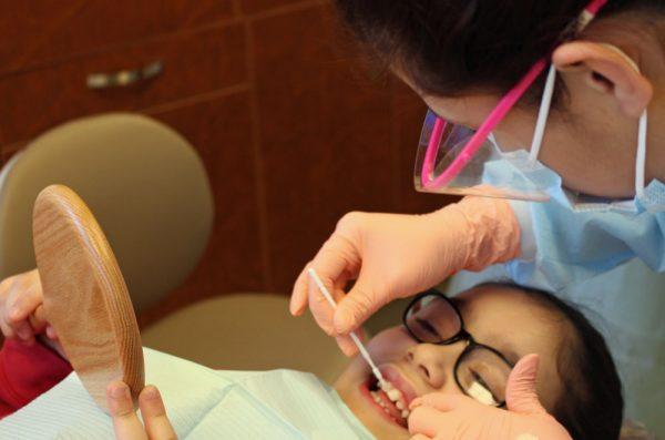 dentist working on child patient