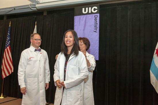 dentist student putting on white coat
