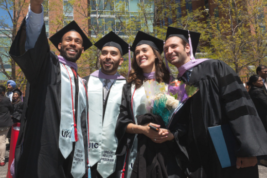 group of students in graduation caps and gown