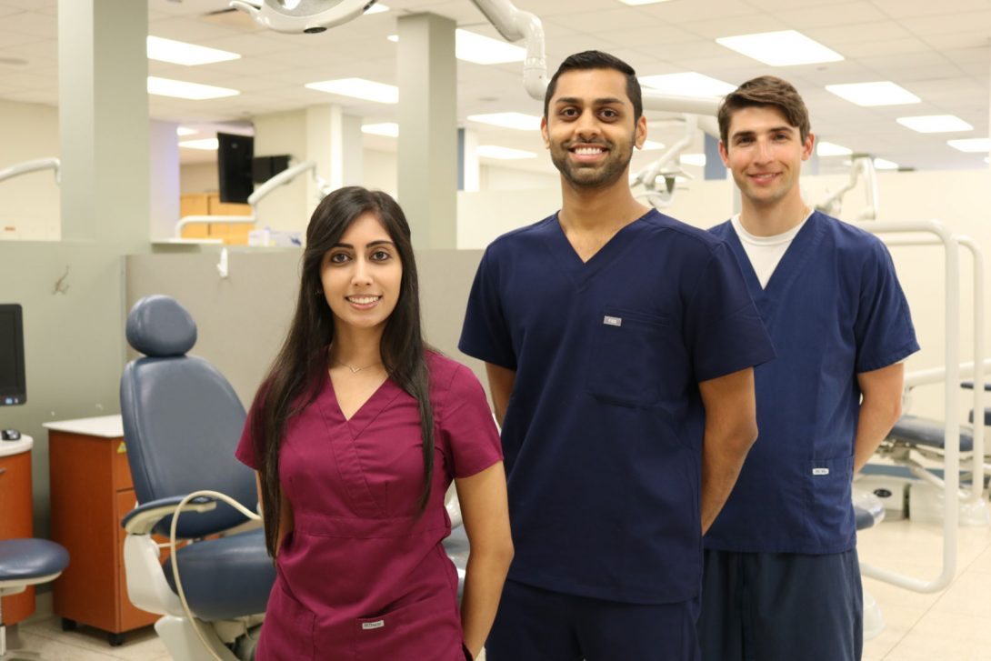 three dentists smiling to camera