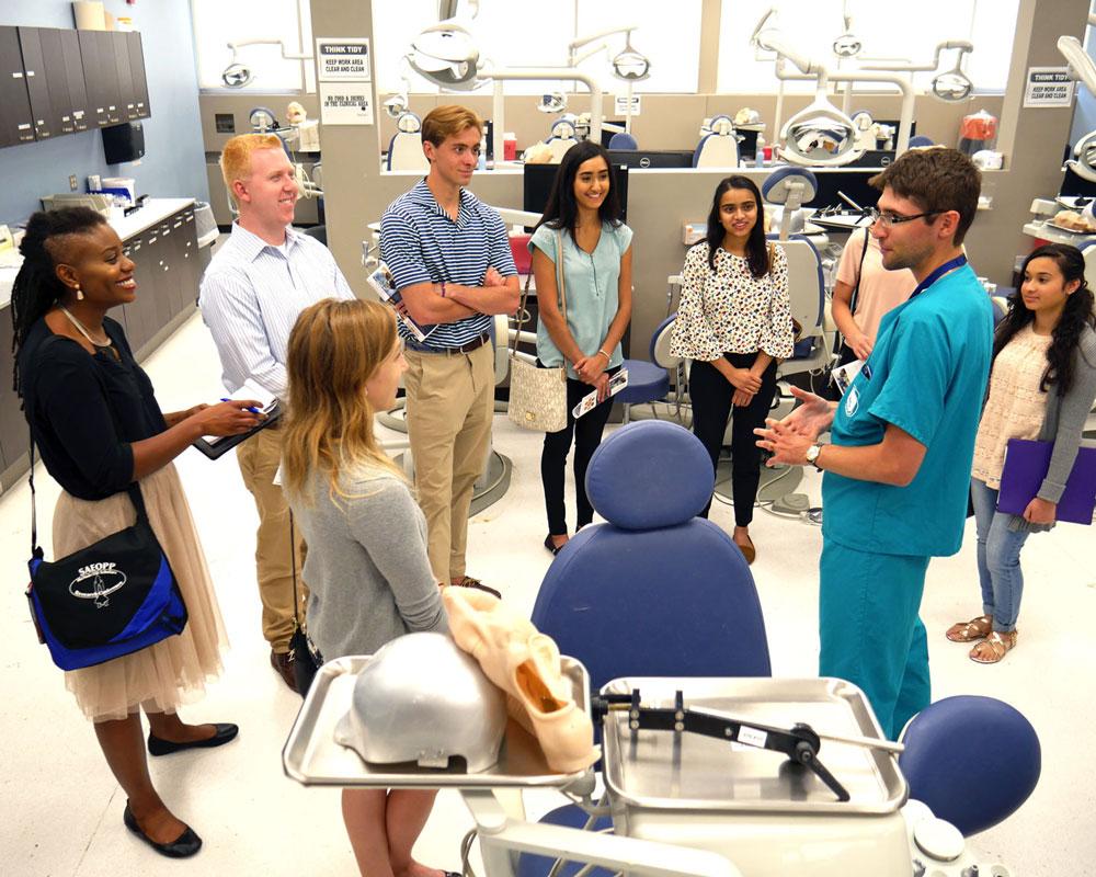 prospective students listening to dentist