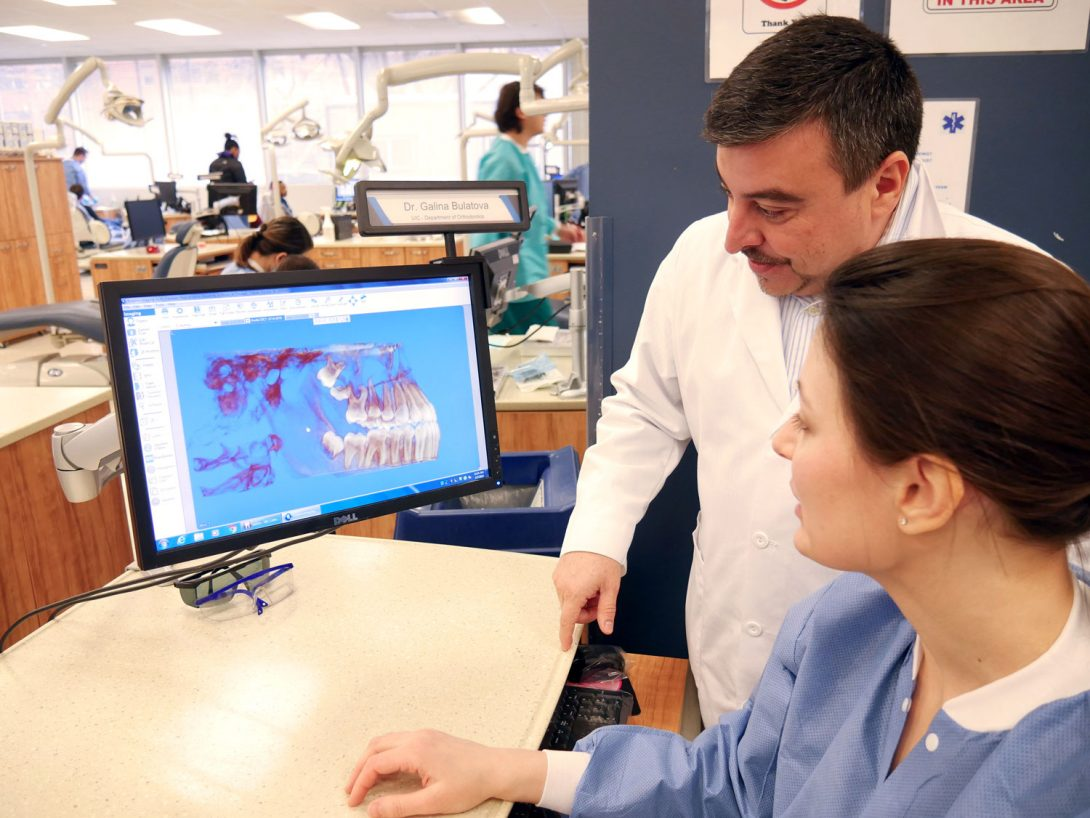 Orthodontic faculty and resident studying patient's 3D image