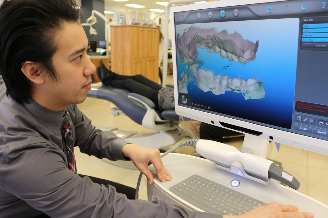 dentist looking a computer screen