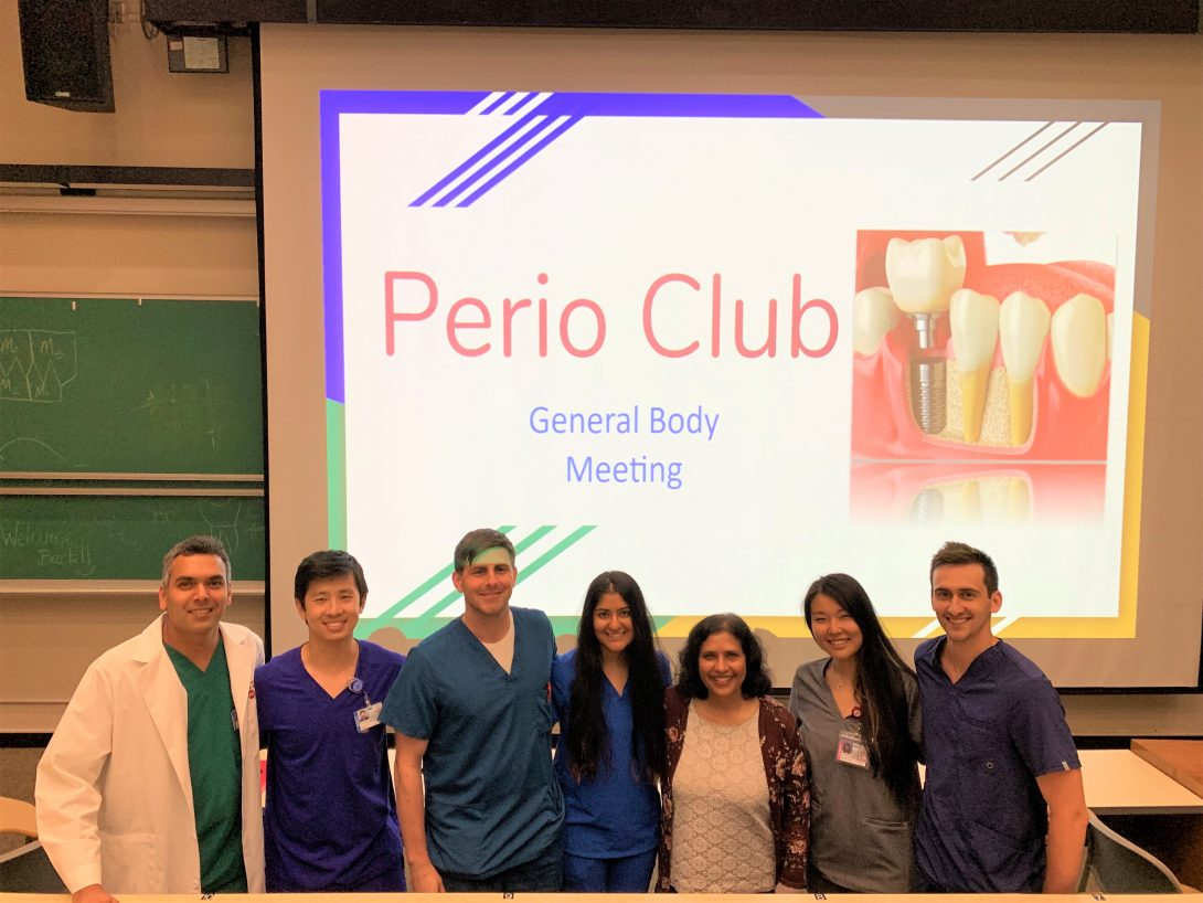 Period Club group photo in front of powerpoint presentation