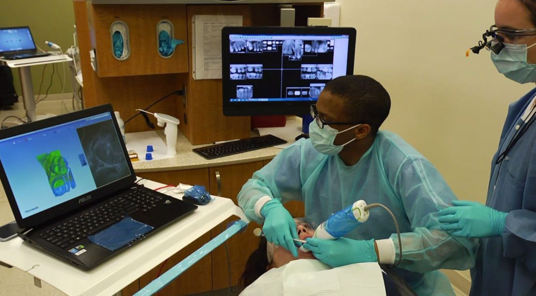 two dentists looking at computer screen