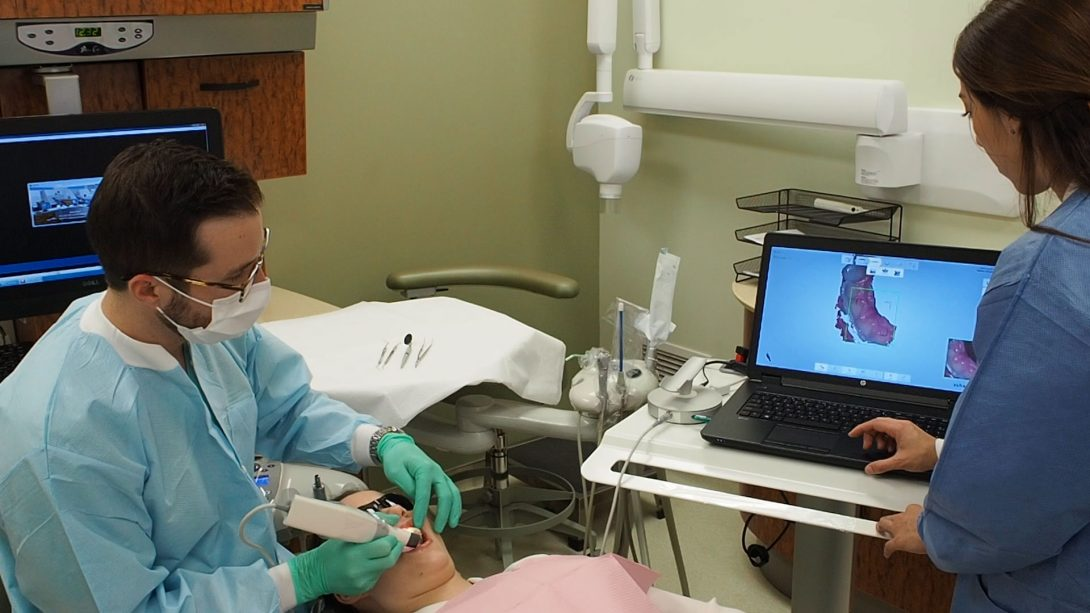 two dentists working on patient