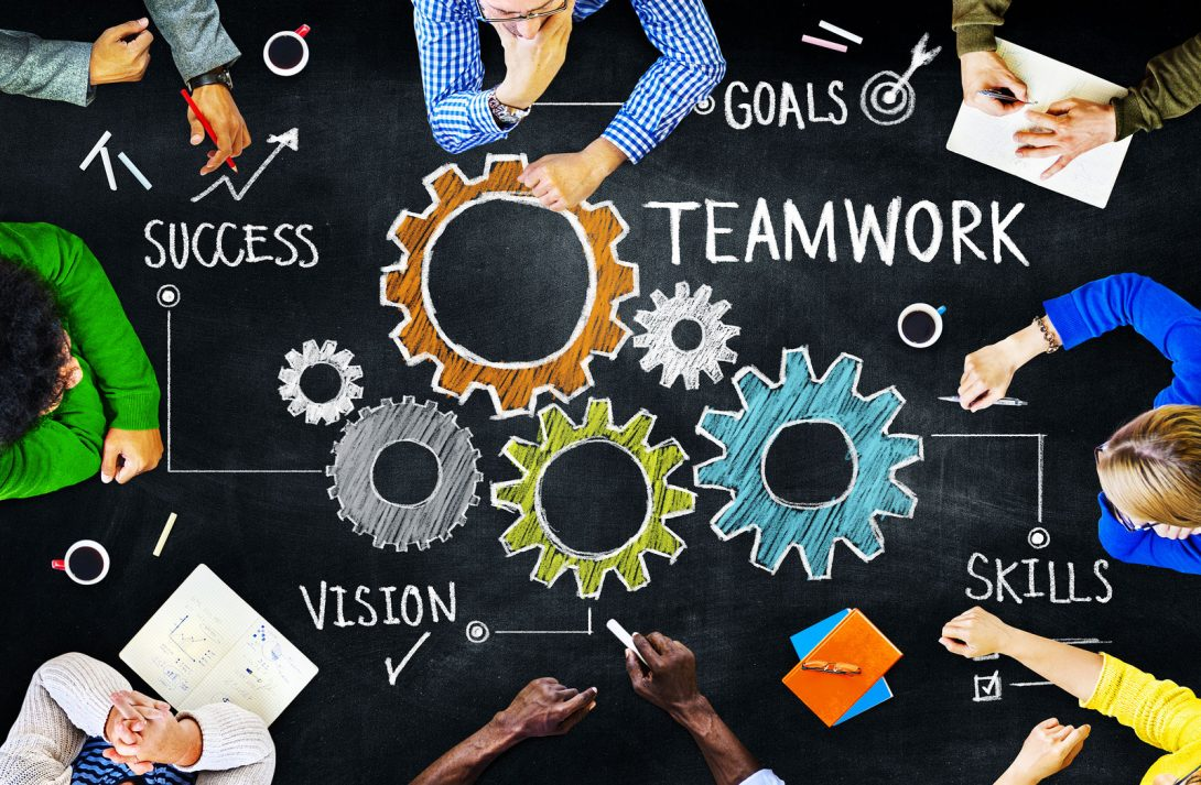 success, teamwork, goals, vision and skills with drawing of gears and people