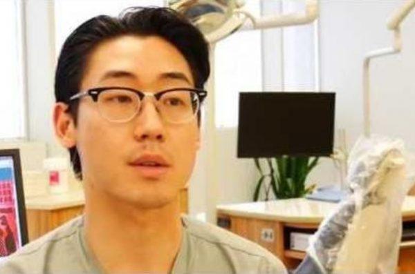 dentist talking to camera