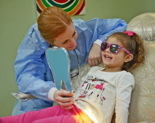 Pediatric dental patient with dentist