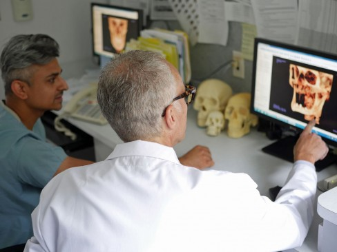two dentists looking a computer screen