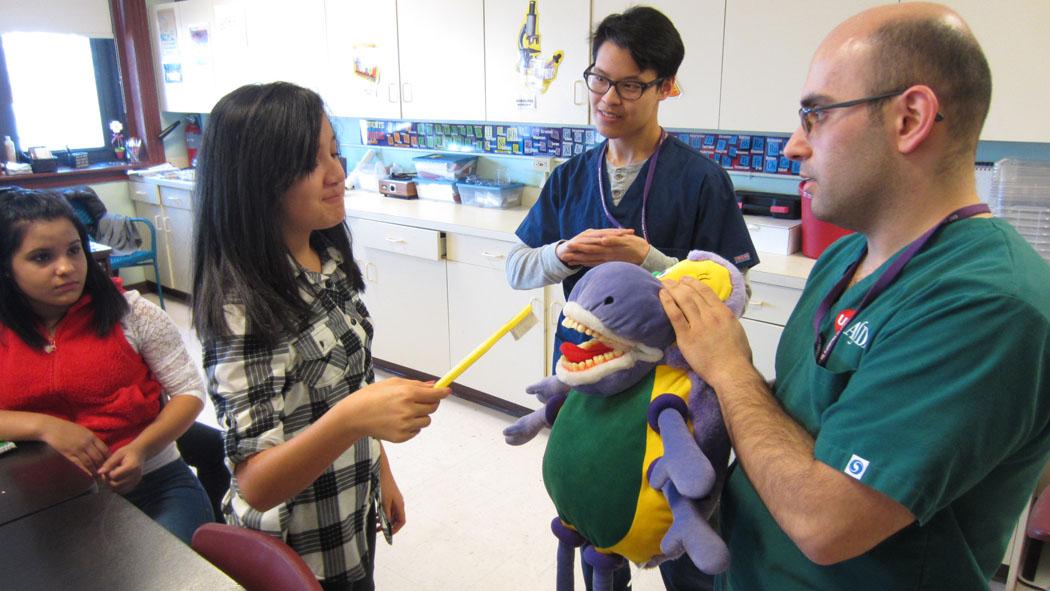 dentists speaking with children