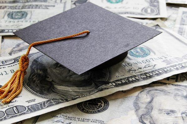 graduate hat on dollar bills